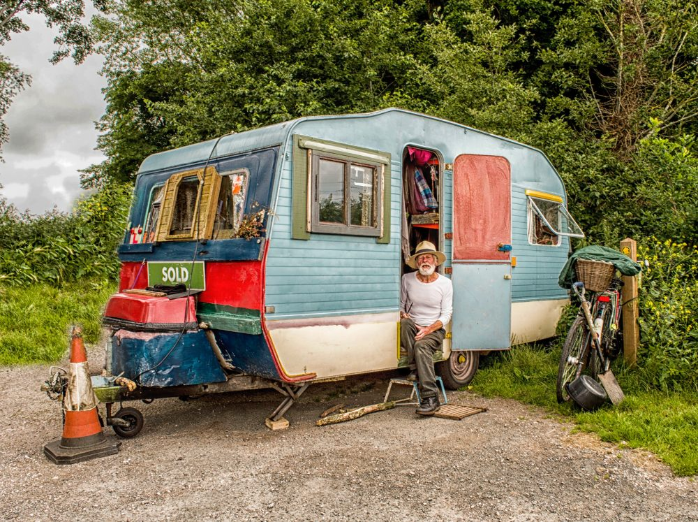 Man with old camper